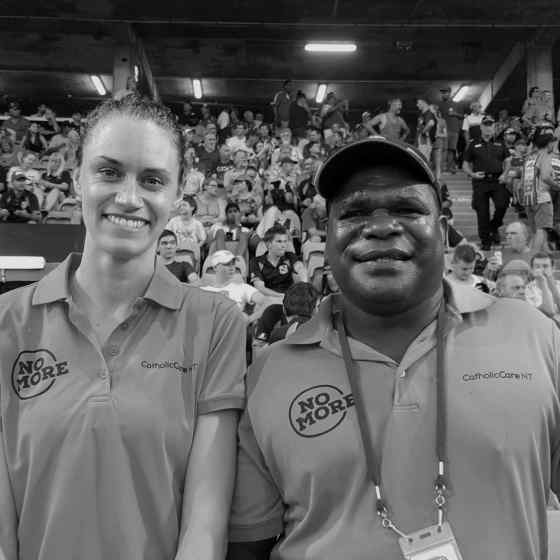 NO MORE Campaign workers, Alex Billeter and Kevin Baxter at the NTFL Grand Final.