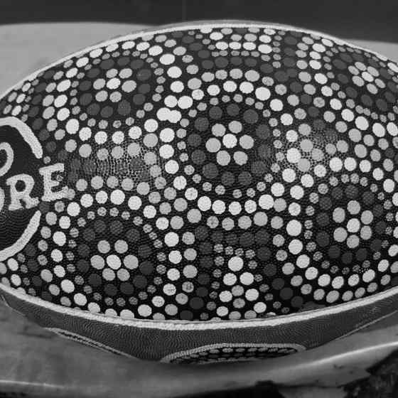 NO MORE NRL ball hand painted by Larrakia woman Rochelle Fejo.