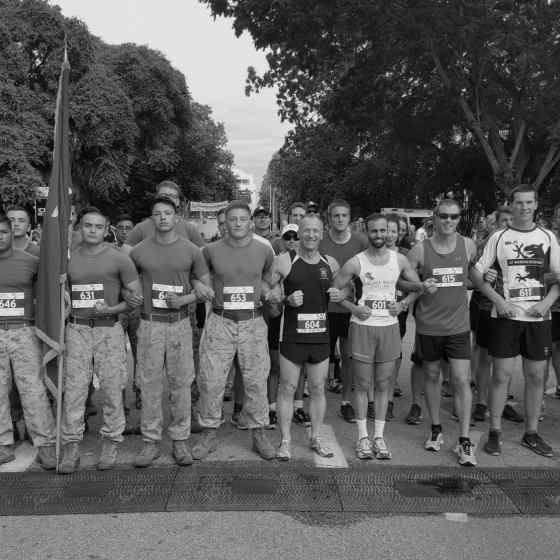 Defence and Services runners including the US Marines link up to show their support and say NO MORE to family violence.