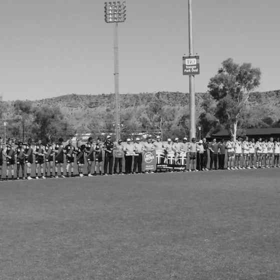 AFLCA Premier League Grand Final teams West Football Club and Federal Football Club link up at Traeger Park in Alice Springs.