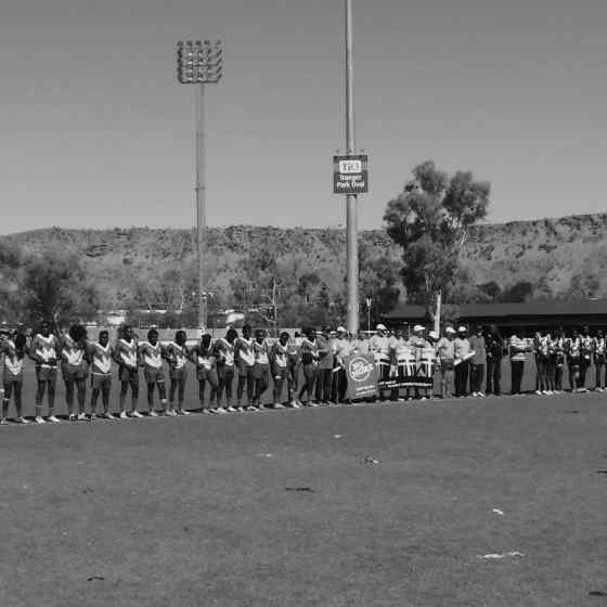 AFLCA Division 1 Grand Final teams Ti Tree Roosters and Yuendumu Magpies link up to say NO MORE to family violence at Traeger Park in Alice Springs.
