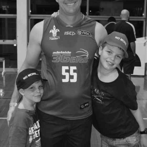 Michael Moriaty with his sons supporting the Adelaide 36ers and NO MORE to family violence.