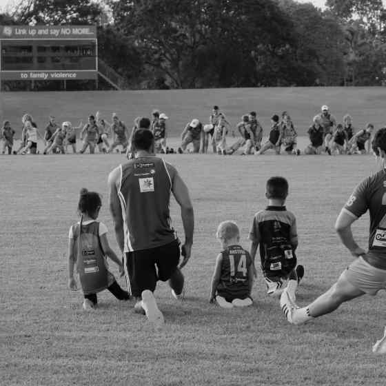 Leading by example, a father spends the training session with his children. Promoting positive and healthy relationships is so important for the juniors coming up through the ranks of football teams.