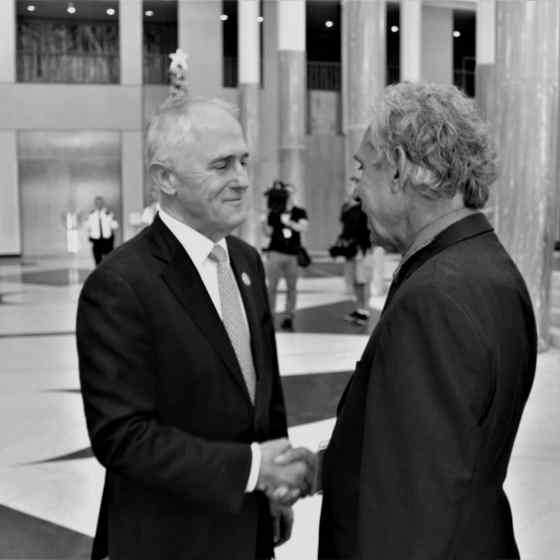 Charlie is greeted by Prime Minister Malcolm Turnbull.