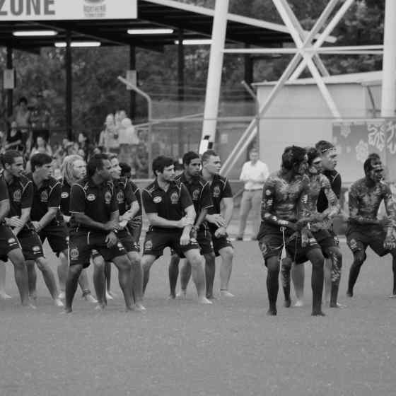 Rio Tinto Footy Means Business Indigenous team showing the crowd their war dance before the NTFL Grand Final match.