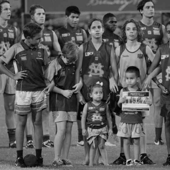 St Marys junior players link arms to say NO MORE to family violence.