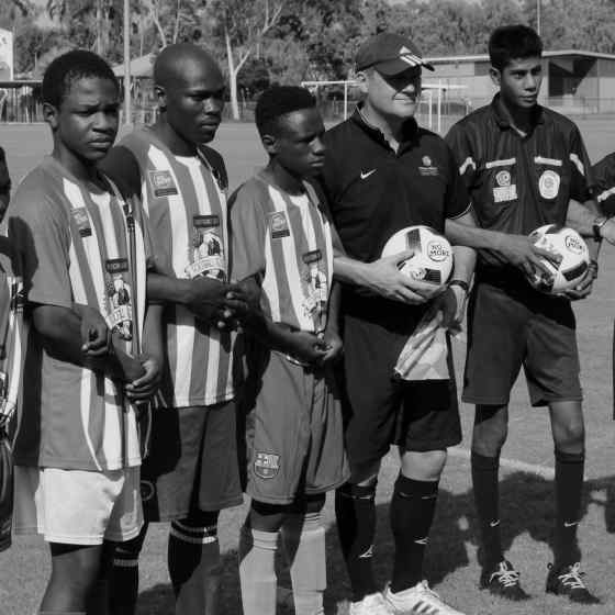 Congolese team and referees linking arms before the match.