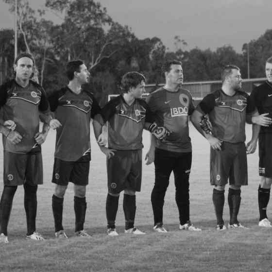Palmerston Football Club link arms before the match.