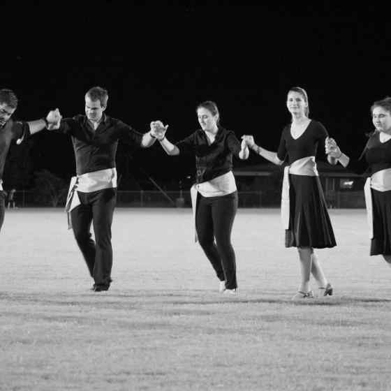 Greek dancers performed at half time of the last game.