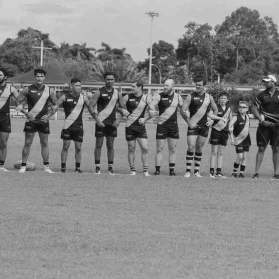 Nightcliff FC link up on the ground before the start of the game. Photo Credit: Lou Reeve