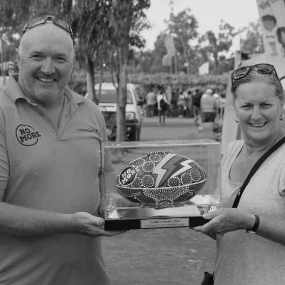 Malcom Fox presents the NT Thunder NO MORE Campaign ball to the raffle winner, Toni.