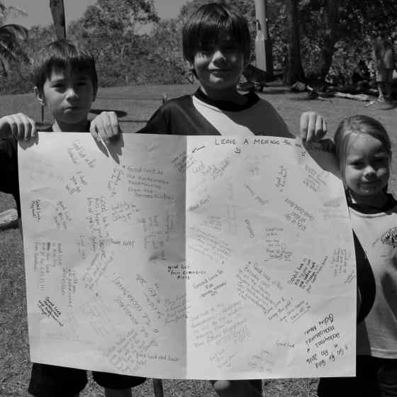 Kids write messages to the Hockeyroos at the Rio Olympics.