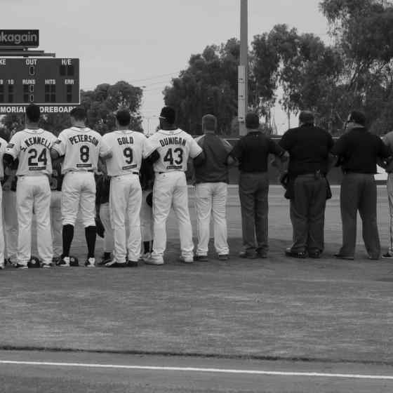 Perth Heat, Canberra Cavalry and umpires link up on the mound. Photo Credit: Wendy De'Souza