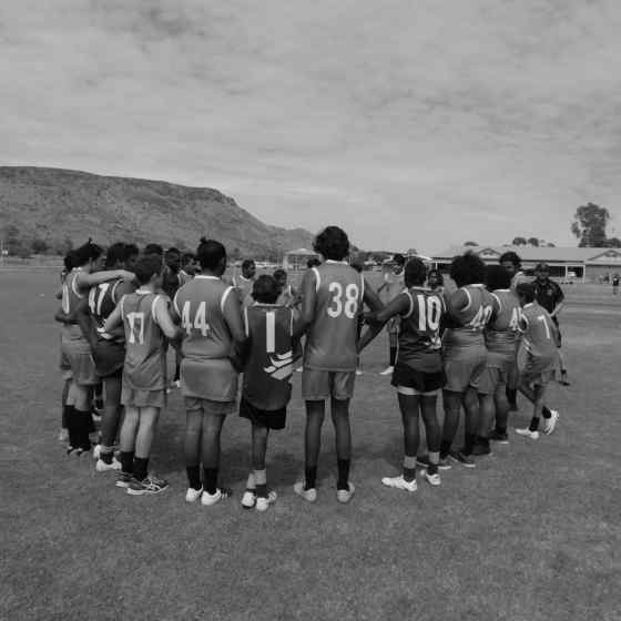 Centralian Middle School and Yirara College link up before the Grand Final match.