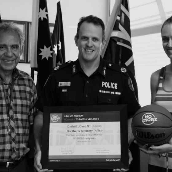NO MORE campaign founder Charlie King and campaign project worker Alex Billeter present an award to NT Police Assistant Commissioner Lance Godwin for their continued support and recognition of the work the NT Police have been doing to end family and domestic violence.