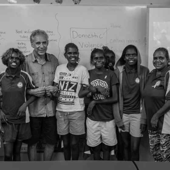 Charlie King links up with students from Maningrida school. Photo Credit: NT Police
