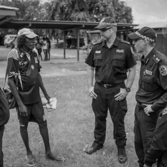 NT Police chat with the local footy chairman. Photo Credit: NT Police