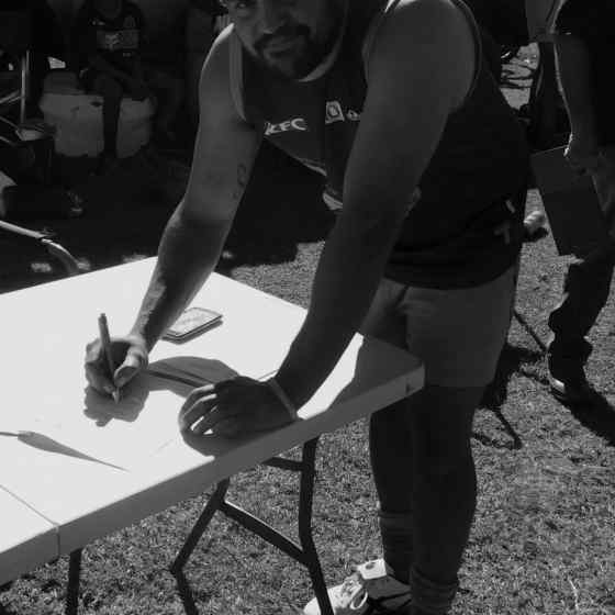 Eric Campbell signs the Pioneer DVAP committing to address issues of family violence within their team.