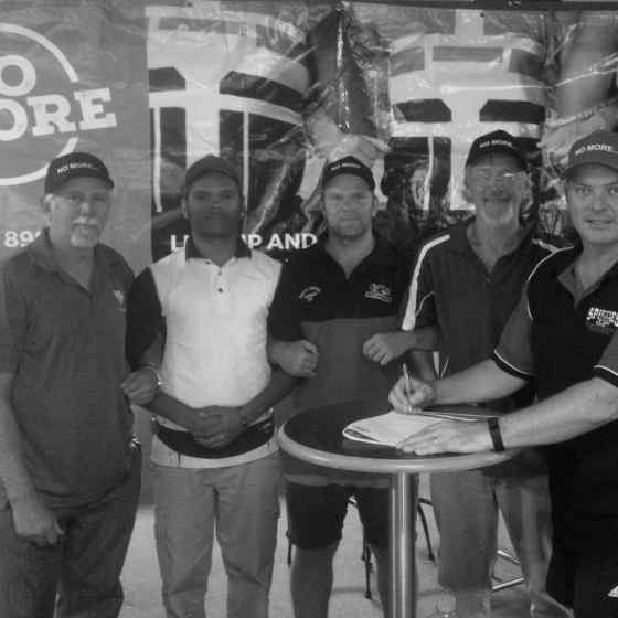 Sporties Spitfires sign their DVAP Agreement at Sporties Club in Tennant Creek on 18 September 2015. From left to right: Roy Arbon (NO MORE), Antonio Riley (Sporties Spitfires Captain), Kym Bracken (senior player), Stan Coombe (NO MORE), Randall Gould (Sporties Spitfires Coach).