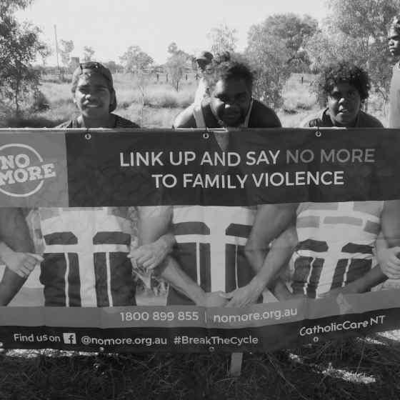 NO MORE Campaign signage around the ground.