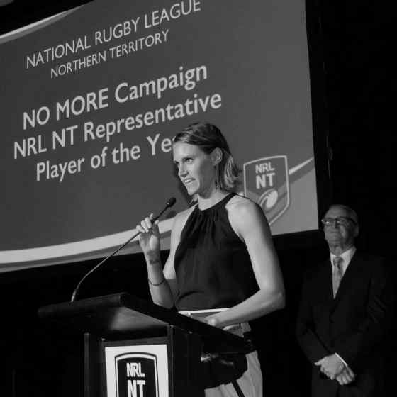 NO MORE Campaign worker Alex Billeter presents the very first NO MORE Campaign Player of the Year Award at the NRL NT Frank Johnson Medal night.